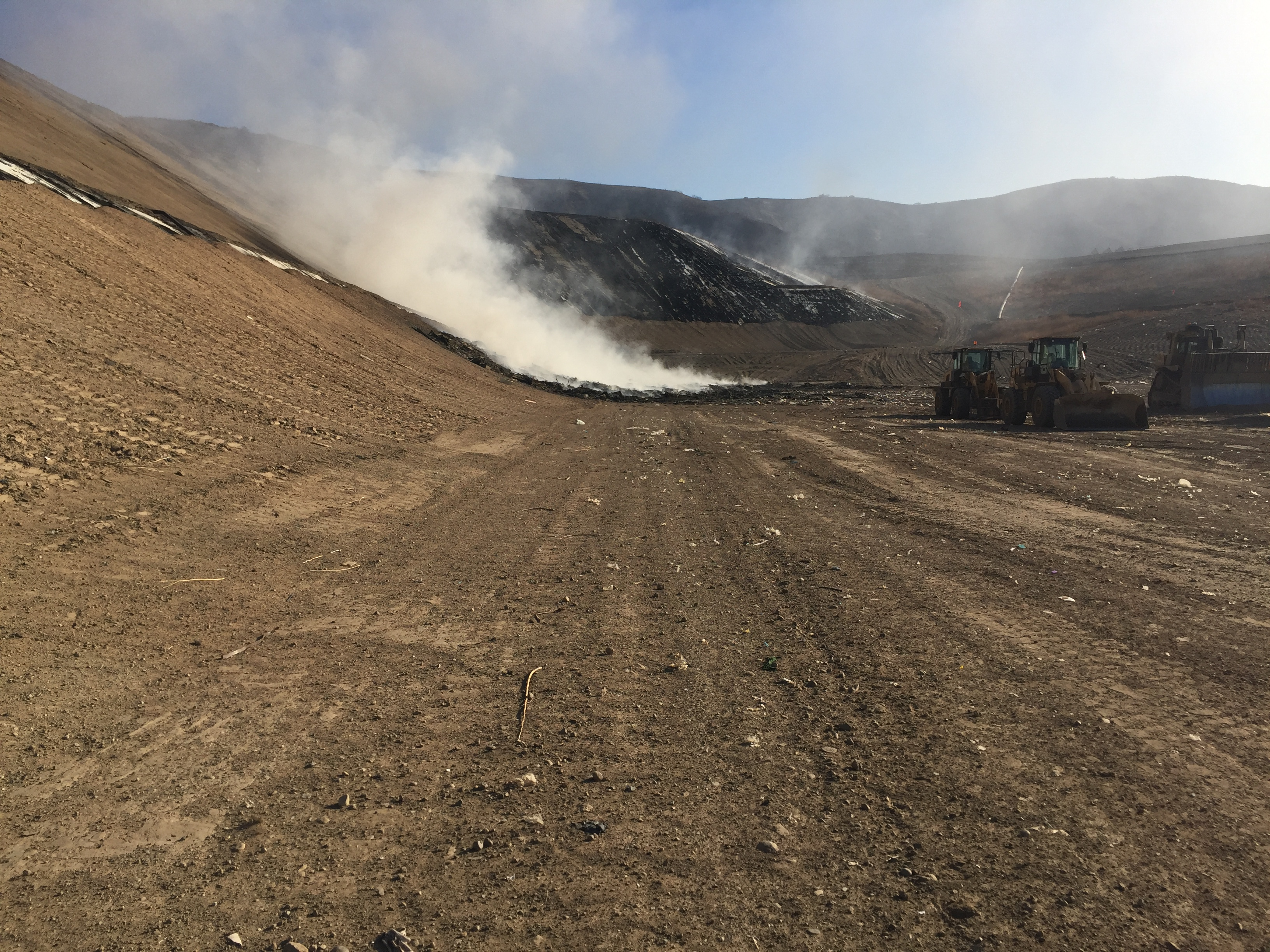 Smoke in the distance at the landfill